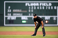 First base umpire Colin Baron works a game between the Greenville Drive and the Asheville Tourists on Friday, August 23, 2019, at Fluor Field at the West End in Greenville, South Carolina. Greenville won, 11-1. (Tom Priddy/Four Seam Images)