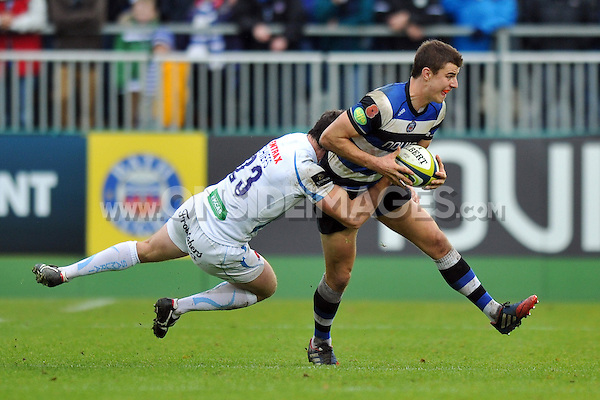Ollie Devoto is tackled in possession. LV= Cup match, between Bath Rugby and Exeter Chiefs on November 17, 2013 at the Recreation Ground in Bath, England. Photo by: Patrick Khachfe / Onside Images