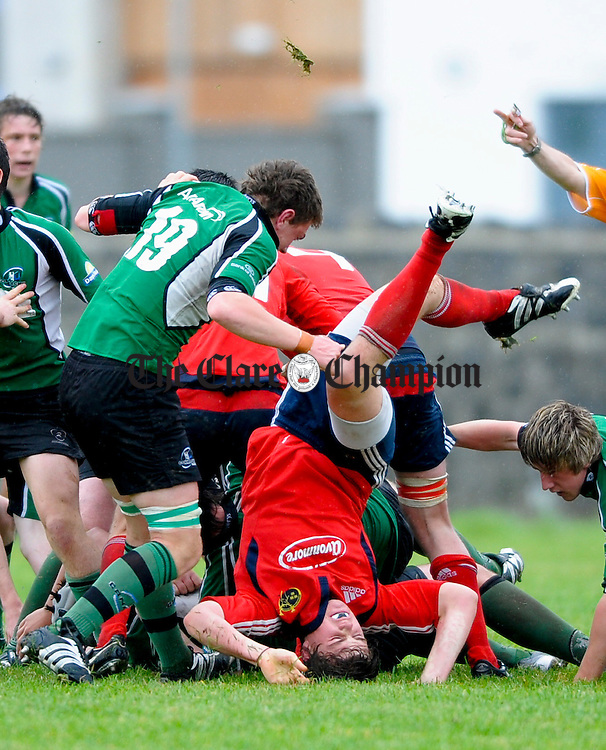 Ennis's Gearoid Crowe of Munster is up-ended by Connaught's A Spring during the Youth's Interprovencial Championship game at Ennis RFC. Photograph by John Kelly.