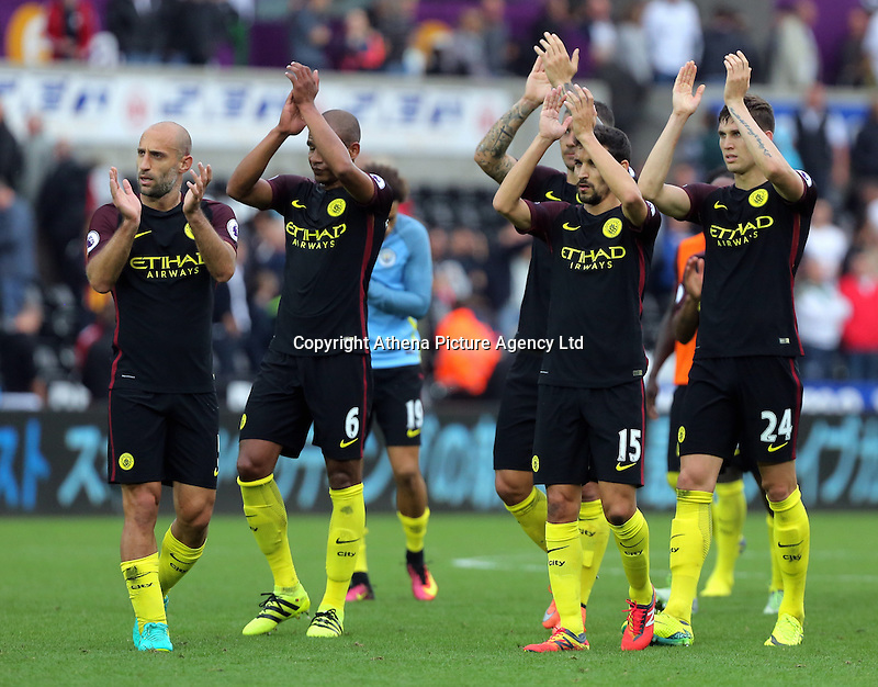 (L-R) Pablo Zabaleta, Fernando, Jesus Navas and John Stones of Manchester City thank their away supporters after the Premier League match between Swansea City and Manchester City at The Liberty Stadium in Swansea, Wales, UK. Saturday 24 September 2016
