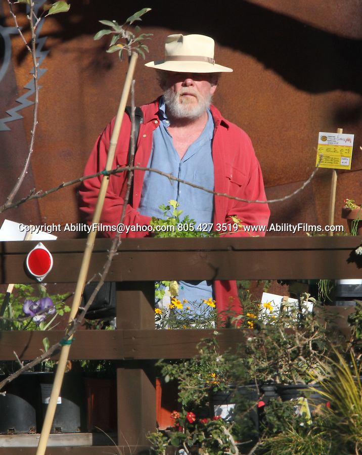 January 14th 2013    Exclusive <br /> <br /> <br /> Nick Nolte playing in the Malibu California park with his daughter Sophie Lane. Nick walked next door and bought a big orange and green squirt gun at the toy store. Then walked across the street &amp; bought some plants <br /> <br /> AbilityFilms@yahoo.com<br /> 805 427 3519 <br /> www.AbilityFilms.com