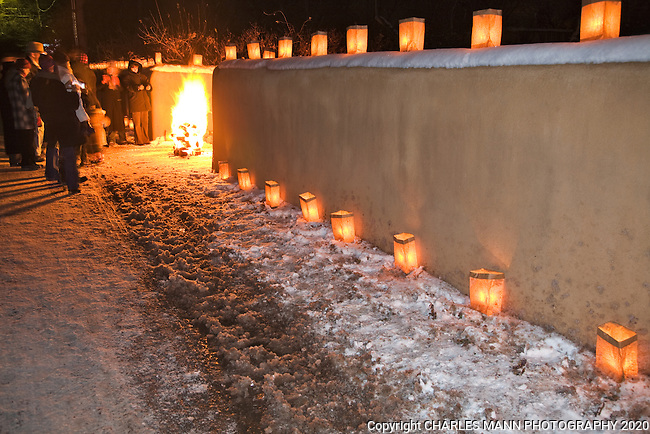 Walls And Walks Are Lined With Paper Bag Faralitos People Warm Themselves By Small Campfires
