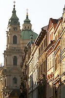 Czeck Republic - Prague, Beauitfully restored and preserved building facades on Mostecká in Malá Strana.  The 'royal way' climbs from the Charles bridge to the Prague castle. Church of St. Nicholas in distance