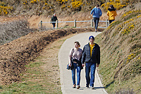 Pictured: A couple walks on the coastal path by Langland Bay near Swansea, Wales, UK. Sunday 22 March 2020<br /> Re: Covid-19 Coronavirus pandemic, UK.