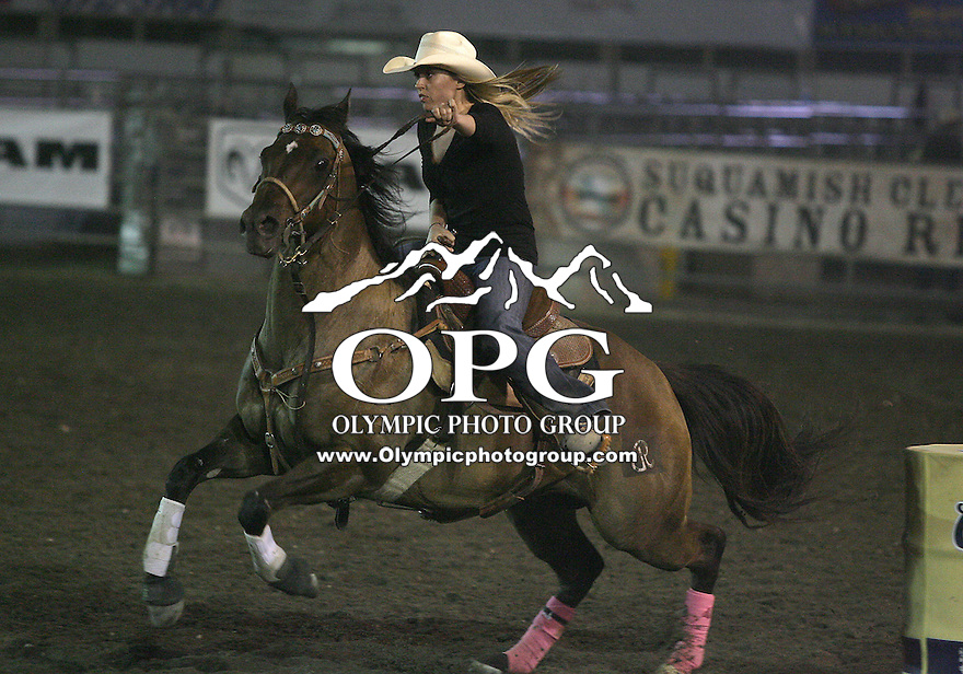 "28 Aug 2010:  Rainy Graham scored a time of 22.81 in the Barrel Racing competition at the Kitsap County Stampede Wrangle Million Dollar PRCA Silver Rodeo Tour Bremerton, Washington. Saturday night was ""TUFF ENOUGH TO WEAR PINK"" for support of Breast Cancer awarness."