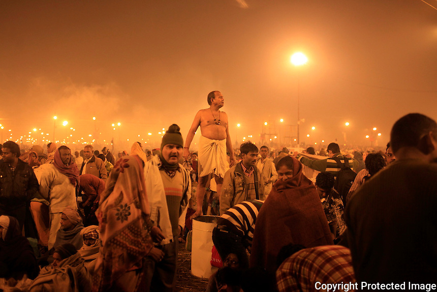 Devotees gather over night for shower in the river early morning of 10th feb during Mahakumbh festival at Allahabad.