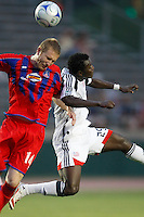 """Crystal Palace defender Mike Lookingland (14) and New England Revolution forward Abdoulie """"Kenny"""" Mansally (29) go up for a header. The New England Revolution (MLS) defeated Crystal Palace FC USA of Baltimore (USL2) 5-3 in penalty kicks after finishing regulation and overtime tied at 1-1 during a Lamar Hunt US Open Cup quarterfinal match at Veterans Stadium in New Britain, CT, on July 8, 2008."""