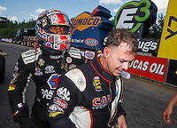 Jun 6, 2016; Epping , NH, USA; NHRA top fuel driver Antron Brown (left) talks with Steve Torrence after winning the New England Nationals at New England Dragway. Mandatory Credit: Mark J. Rebilas-USA TODAY Sports