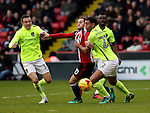 Billy Sharp of Sheffield United tussles withLewin Nyatanga of Northampton Town during the English Football League One match at Bramall Lane, Sheffield. Picture date: December 31st, 2016. Pic Jamie Tyerman/Sportimage
