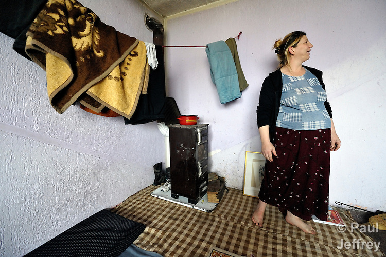 Giltena Duda in her home in the Zemun Polje Roma neighborhood of Belgrade, Serbia. Ms. Duda is pregnant with her seventh child. She and her husband are Roma refugees from Kosovo, and thus legally marginalized in Serbia. They built their home on unregistered land and pirate their electrical hookup. Without legal residency, their children can't attend a regular school, and they have difficulties getting formal employment. Yet both adults participate in a literacy program sponsored by the Branko Pesic School, where their children attend classes. The school is supported by Church World Service.
