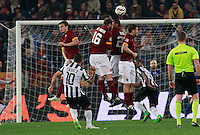 Carlos Tevez  shoots and scores during the Italian Serie A soccer match between   AS Roma and Juventus FC       at Olympic Stadium      in Rome ,March 02 , 2015