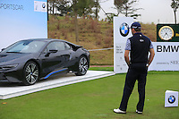 Graeme McDowell (NIR) checks out the hole in one prize a BMW i8 on the 17th tee during Wednesday's Pro-Am Day of the 2014 BMW Masters held at Lake Malaren, Shanghai, China 29th October 2014.<br /> Picture: Eoin Clarke www.golffile.ie