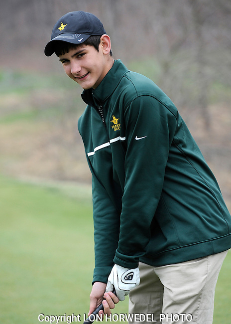 Huron High School boy's golf team at Leslie Park Golf Course in Ann Arbor, Friday, April 25, 2014.