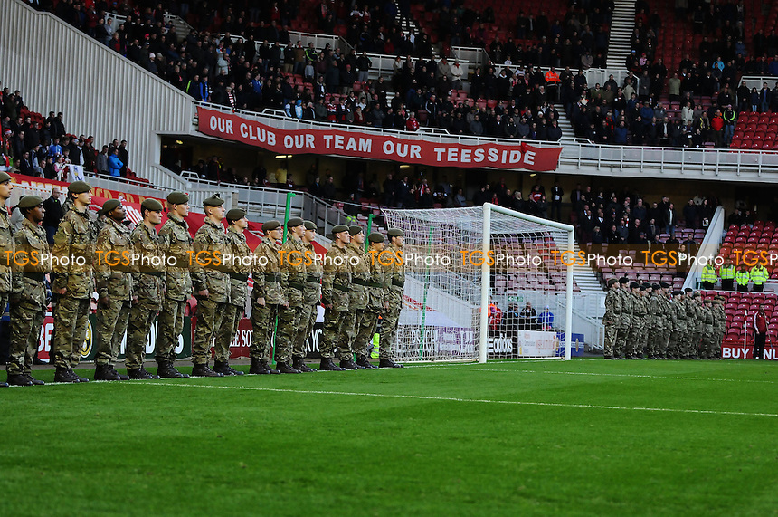 Solders surround the pitch during the minutes silence - Middlesbrough vs Watford - Sky Bet Championship Football at the Riverside Stadium, Middlesbrough - 09/11/13 - MANDATORY CREDIT: Steven White/TGSPHOTO - Self billing applies where appropriate - 0845 094 6026 - contact@tgsphoto.co.uk - NO UNPAID USE