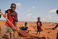 Kenya - Dadaab - Somali children work in an improvised brick factory in the refugee camp.