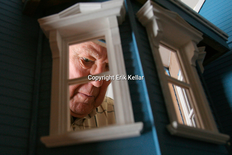 Residents of Aston Gardens in North Naples work on building a doll house the plan to donate to a childrens hospital. Te Group raised money to pay for the house through a series of white elephant sales and have worked on it for several weeks. Erik Kellar