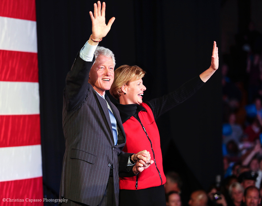 October 19, 2012- Green Bay, United States: Congesswoman Tammy Baldwin and former President Bill Clinton wave to a crowd of supporters at the UW-Green Bay campus. Clinton was in the battleground state campaigning for President Obama and gave an hour long speech to a crowd of 2,200 people. (Christina Capasso/Polaris)