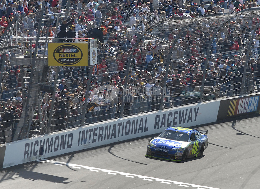 May 6, 2007; Richmond, VA, USA; Nascar Nextel Cup Series driver Jimmie Johnson (48) takes the checkered flag to win the Jim Stewart 400 at Richmond International Raceway. The race is being run on Sunday after being rained out on Saturday evening. Mandatory Credit: Mark J. Rebilas-US PRESSWIRE Copyright © 2007 Mark J. Rebilas