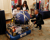 United States President Barack Obama looks at the invention of Sergio Corral and Isela Martinez from Phoenix, Arizona, leaders of the robotics program from Carl Hayden High School during the 2015 White House Science Fair, a celebration of students winners of STEM (Science, technology, engineering and math) competitions from across the country on March 23, 2015,  at the White House in Washington, DC.<br /> Credit: Aude Guerrucci / Pool via CNP