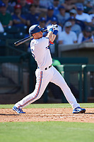 Matt Duffy (5) of the Texas Rangers follows through on a swing during a Cactus League Spring Training game against the Los Angeles Dodgers on March 8, 2020 at Surprise Stadium in Surprise, Arizona. Rangers defeated the Dodgers 9-8. (Tracy Proffitt/Four Seam Images)