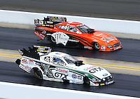 Sep 15, 2013; Charlotte, NC, USA; NHRA funny car driver John Force (near) defeats Johnny Gray during the Carolina Nationals at zMax Dragway. Mandatory Credit: Mark J. Rebilas-