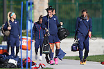 14 October 2014: Ali Krieger (center) leads her teammates into the park, including Tobin Heath (right) and Julie Johnston (left). The United States Women's National Team held a training session on the stadium field at Swope Park Soccer Village in Kansas City, Missouri in preparation for the CONCACAF Women's World Cup Qualifying Tournament for the 2015 Women's World Cup in Canada.