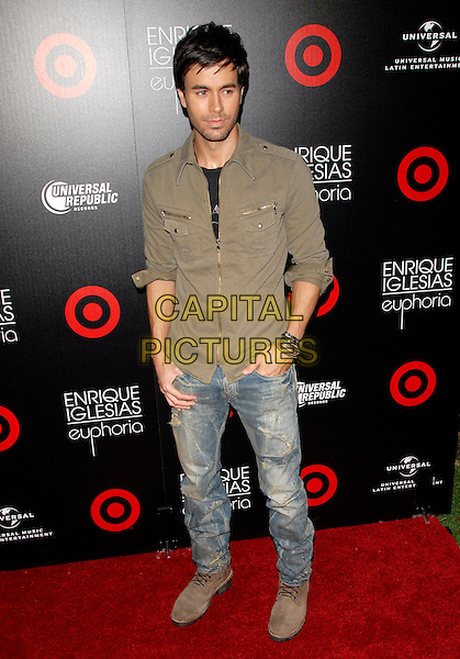 ENRIQUE IGLESIAS .at the Target and Enrique Iglesias Launch Party of the Exclusive Deluxe Version of Euphoria at MyHouse in Hollywood, California, June 6th 2010..full length jeans hands in pockets  green khaki jacket beard facial hair .CAP/RKE/DVS.©DVS/RockinExposures/Capital Pictures.
