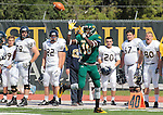 SEPTEMBER 13, 2014 -- Anthony Ebereime #18 of Black Hills State makes a reception in front of the South Dakota Mines bench during their college football game Saturday at Lyle Hare Stadium in Spearfish, S.D.  (Photo by Dick Carlson/Inertia)