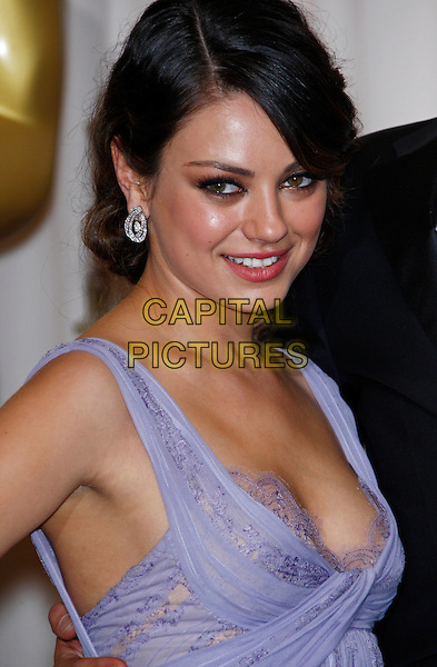 MILA KUNIS.83rd Annual Academy Awards - Oscars.Kodak Theatre, Hollywood, CA, USA..February 27th, 2011 .Pressroom press room winner trophy headshot portrait purple cleavage lace .CAP/PE.©Peter Eden/Capital Pictures.