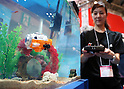 "June 9, 2016, Tokyo, Japan - An employee of Japanese toy maker CCP displays a submarine toy with digital camera ""Submarine Camera"", controled by infrared ray at the annual Tokyo Toy Show in Tokyo on Thursday, June 9, 2016. Some 160,000 people are expecting to visit the four-day toy trade show.   (Photo by Yoshio Tsunoda/AFLO) LWX -ytd-"