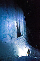 An ice climber ascends a frozen waterfall in Hyalite Canyon near Bozeman, Montana.