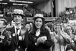 Two Young Conservatives wearing hats applaud their leader. Conservative Party Conference 1980. Strike back with the Tories.