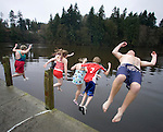 Tacoma residents (L to R) Joni Irvin, Andre Irvin, Shannon Reed, Rachel Reed and Bryan Reed leap into the Burley Lagoon during the 25th annual Polar Bear jump in Olalla, Washington on January 1, 2009. Jim Bryant Photo. ©2010. ALL RIGHTS RESERVED.