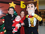 Ian, Pamela and Georgia Rice pictured with Woody at Santa's grotto at the Drogheda Town Centre. Photo: Colin Bell/pressphotos.ie