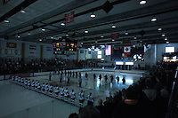 Players and fans stand for the national athem at Ritter Arena in Rochester, New York on October 19, 2012