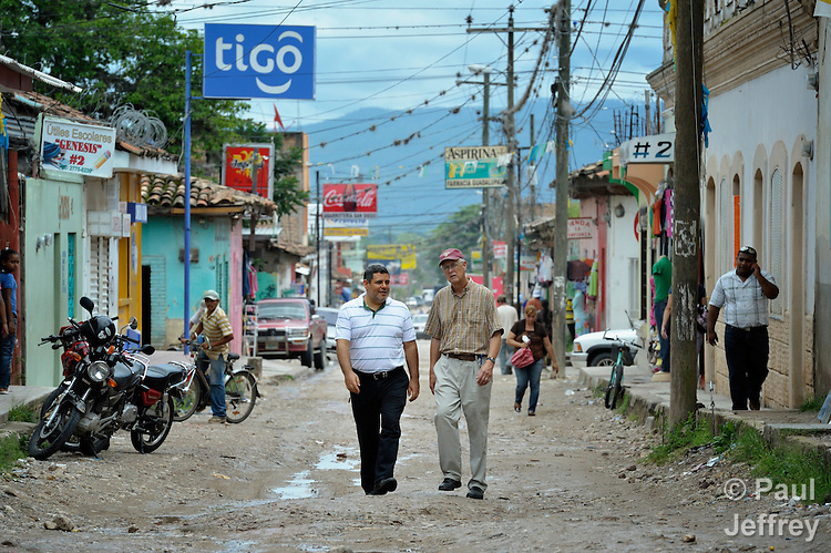 Juan Guerrero (left) and Ronald Davidson are United Methodist missionaries in Honduras. Here they walk through the streets of Talanga.