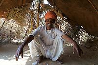 Musician Bapuram of Bhopa cast (musicians) in his tent in the desert outside Pushkar, Rajastan, India