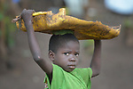 A boy carries a piece of plastic on his head in a camp for more than 5,000 displaced people in Riimenze, in South Sudan's Gbudwe State, what was formerly Western Equatoria. Families here were displaced at the beginning of 2017, as fighting between government soldiers and rebels escalated.<br /> <br /> Two Catholic groups, Caritas Austria and Solidarity with South Sudan, have played key roles in assuring that the displaced families here have food, shelter and water.