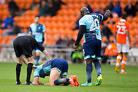 Danny Rowe of Wycombe Wanderers goes down injured after taking the ball to the face from close range during the Sky Bet League 2 match between Blackpool and Wycombe Wanderers at Bloomfield Road, Blackpool, England on 20 August 2016. Photo by James Williamson / PRiME Media Images.