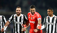 Calcio, Serie A: Fiorentina - Juventus, stadio Artemio Franchi Firenze 9 febbraio 2018.<br /> Juventus' Gozalo Higuain (l), Gianluigi Buffon (c) and Douglas Costa (r) celebrate after winning 2-0 the Italian Serie A football match between Fiorentina and Juventus at Florence's Artemio Franchi stadium, February 9, 2018.<br /> UPDATE IMAGES PRESS/Isabella Bonotto