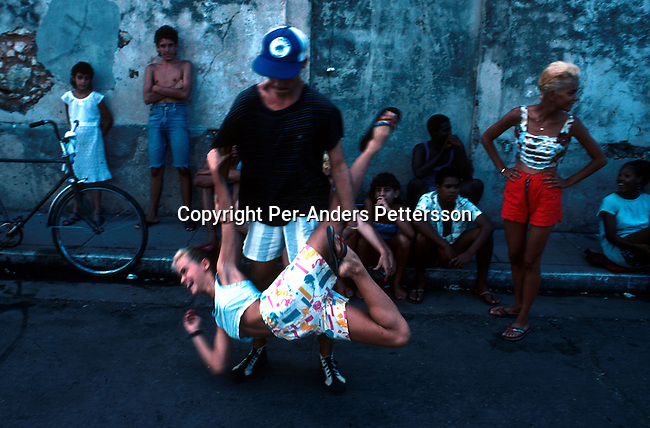 Unidentified youths dancing in a street on July 10, 1993 in a square in central Havana, Cuba. Fidel Castro has ruled the communist island for over 4 decades and been in war of words with the United States all since then. They country has a good eduacation and medical level but lacks freedom of the press and speech. .(Photo: Per-Anders Pettersson/ Getty Images)