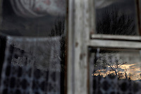 BULGARIA, Lazhnitsa, April 17, 2011. A landscape is reflected in the window of a house in the remote village of Lazhnitsa in the Rhodope Mountains. southern Bulgaria. Bulgarian Muslims, which today are nearly 8% of the country's population and the largest muslim minority community in the European Union, revived their cultural and religious traditions after the fall of communist regime in Bulgaria in 1989. .BULGARIE, Lazhnitsa, 17 Avril 2011. Un paysage se reflète dans la fenêtre d'une maison du petit village de Lazhnitsa dans les montagnes des Rhodopes en Bulgarie. La minorité musulmane qui représente aujourd'hui près de 8% de la population totale du pays et qui est la plus large majorité musulmane dans les pays de l'Union Européenne a ravive ses traditions culturelles et religieuse après la chute du régime communiste Bulgare en 1989.