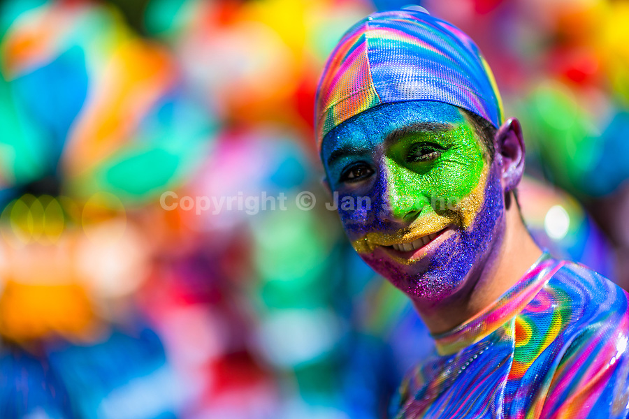 A young Mexican man, having his face colorfully painted with glitter colors, takes part in the Day of the Dead festivities in Mexico City, Mexico, 29 October 2016. Day of the Dead (Día de Muertos), a syncretic religious holiday combining the death veneration rituals of the ancient Aztec culture with the Catholic practice, is celebrated throughout all Mexico. Based on the belief that the souls of the departed may come back to this world on that day, people gather at the gravesites in cemeteries praying, drinking and playing music, to joyfully remember friends or family members who have died and to support their souls on the spiritual journey.