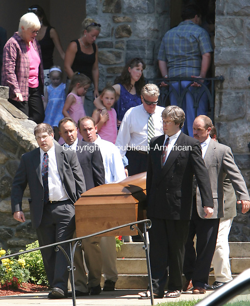 NORFOLK,  CT 04 August 2005 -080405BZ01-    <br /> Pallbearers carrying the casket of Chip Stotler, of New Hartford, exit the Immaculate Conception Church after Stotlers funeral Thursday.  Stotler was killed in a horrific auto accident in Avon last week.<br /> Jamison C. Bazinet Photo
