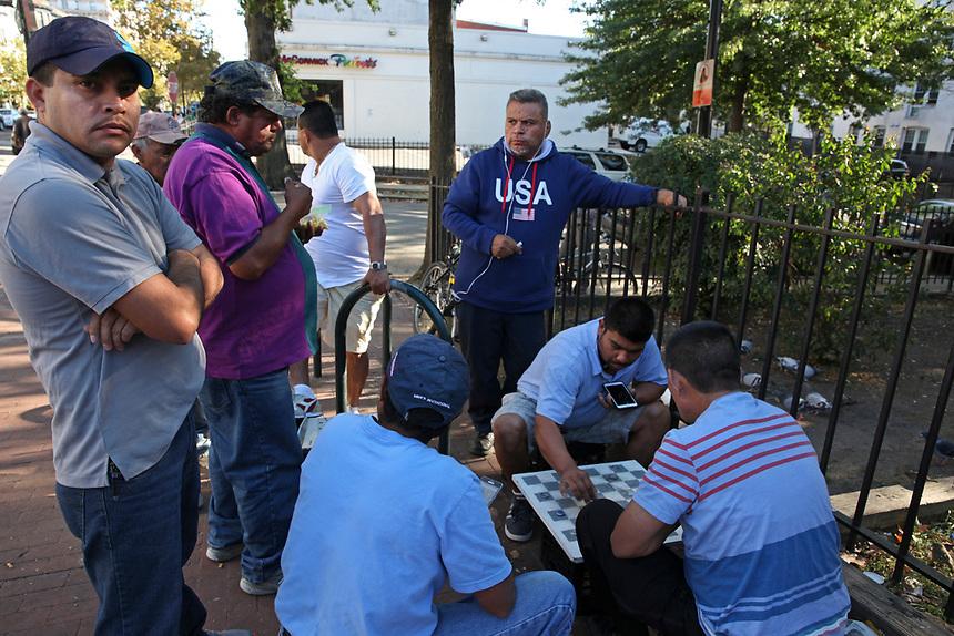 (170929RREI2838) La Esquina. The Latinos at the corner of Mt. Pleasant St. and Kenyon St. NW. Washington DC September 29 ,2017 . ©  Rick Reinhard  2017     email   rick@rickreinhard.com