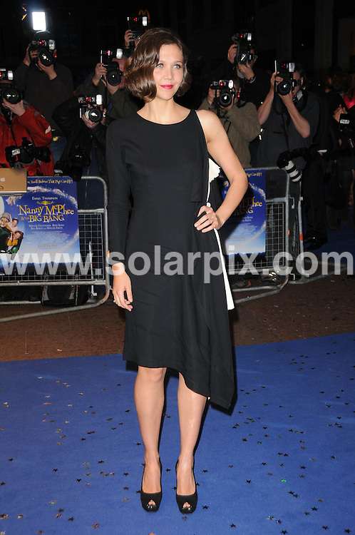 **ALL ROUND PICTURES FROM SOLARPIX.COM**.**WORLDWIDE SYNDICATION RIGHTS**.the UK premiere of Nanny McPhee And The Big Bang, .Odeon West End, Leicester Square, London, UK. 24 March 2010..This pic: Maggie Gyllenhaal..JOB REF: 10974 MSR    DATE: 24_03_2010.**MUST CREDIT SOLARPIX.COM OR DOUBLE FEE WILL BE CHARGED**.**MUST NOTIFY SOLARPIX OF ONLINE USAGE**.**CALL US ON: +34 952 811 768 or LOW RATE FROM UK 0844 617 7637**