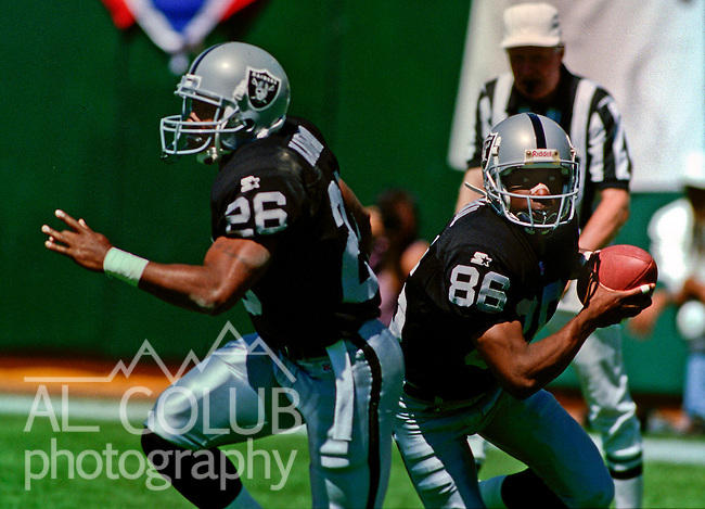 Oakland Raiders vs. San Diego Chargers at Oakland Alameda County Coliseum Sunday, September 3, 1995.  Raiders beat Chargers  17-7.  Oakland Raiders running back Napoleon Kaufman (26) blocks for wide receiver Rocket Ismail (86).