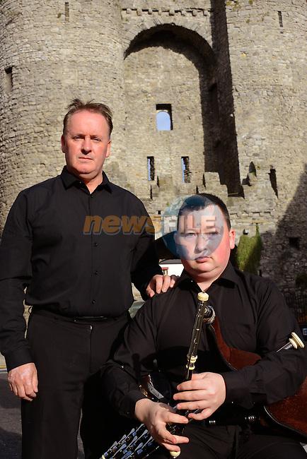 Ken O'Heiligh and his son the piper Darragh O'Heiligh at Laurences Gate.