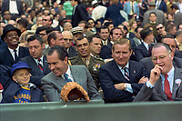 "President Nixon holds ""a frank exchange of views"" with a young basefall fan at the Washington Senators' Opening Day game versus the New York Yankees at RFK Stadium<br /> <br /> PHOTO : Robert L. Knudsen, White House photographer,"