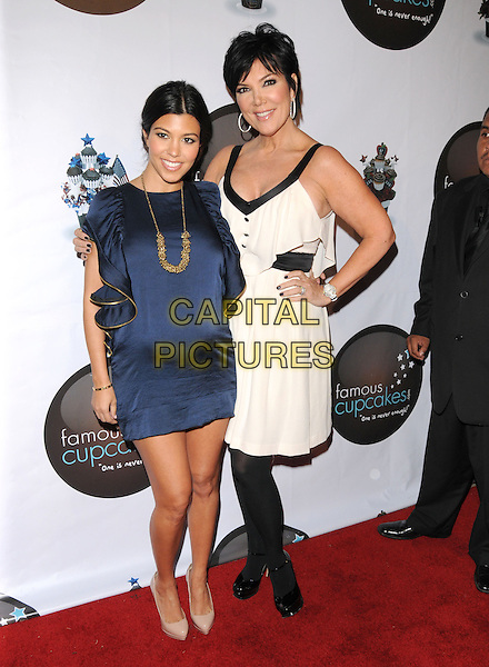 KOURTNEY KARDASHIAN & KRIS JENNER .at The Famous Cupcakes Beverly Hills Grand Opening, Beverly Hills, California, USA, October 7th,2009..full length hand on hip gold necklace ruffles ruffle pregnant maternity  mini side  blue dress navy beige shoes heels pointy platform mom mum  mother daughter white hand on hip tall short arm around tights patent .CAP/DVS.©DVS/RockinExposures/Capital Pictures.